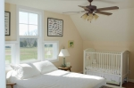 2nd floor guest bedroom with windows overlooking the front pasture and garden area