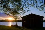 Breathtaking sunset silhouettes the boathouse