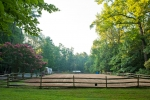 Large dressage ring behind the main barn