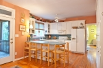 Spacious kitchen with plenty of cabinet and pantry space