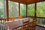 Eat and relax inside the screened in porch
