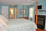 Master bedroom with gas logs, 2 closets, and full bath that overlooks the back yard and pasture
