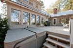 Spacious back deck with a top-of-the-line hot tub