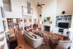 Spacious living area with fireplace and vaulted ceilings