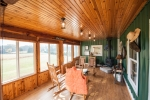 Comfortable gathering area with HVAC, wood burning stove & excellent views of the farm