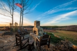 Stone patio and fireplace overlooking the rolling countryside