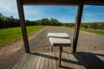 Concrete shooting bench has been built into the shop's porch