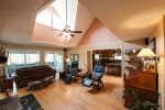 Spacious family room with excellent lighting.  This room also has direct access to the sunroom and screened in porch