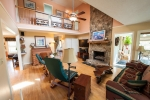 Beautiful stone fireplace serves as a centerpiece to the family room
