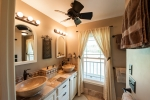Master bath is also equipped with stone vessel sinks and travertine stone countertops