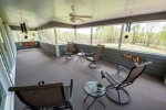 Large screened-in porch with plenty of room to relax