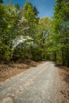 Gravel driveway measures nearly one half mile