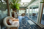 Lovely sunroom is perfect for reading and wildlife viewing