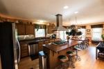Quartz countertops, stainless steel appliances, backsplash, and recessed lighting