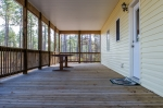 Spacious back porch is ideal for entertaining and relaxing