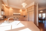 Kitchen has direct access to the informal dining room, laundry room, and garage