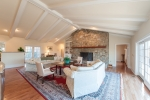 Living room has vaulted ceilings, stone fireplace, and wetbar