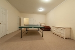 Large room in basement currently being used as a second game room