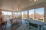 Enjoy sweeping vistas from the sunroom