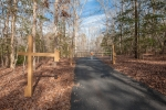 Gated entrance and paved driveway measures 1,050ft