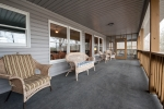 Massive back porch is ideal for relaxing with friends and family