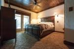 First floor master bedroom with doors accessing the deck