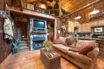 Stone gas fireplace in the den