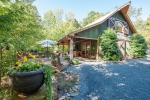 Secluded and well-built custom 1.5 story barn-style lodge with Hyco Lake views