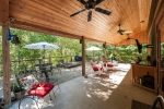 Spacious covered patio and deck equipped with hot tub, ceiling fans, tv and speakers