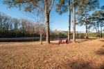Private 2.6ac pond located directly behind the home