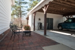 Brick patio, carport, and enclosed shop