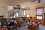 Spiral staircase leads to the upstairs master suite