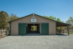 6 stall center aisle barn with roof overhang- metal roof and siding