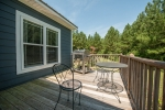 Rear porch extending off the enclosed sun porch