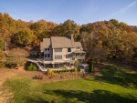 Massive back deck, patio and several porches offer stunning views of the surrounding countryside
