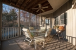 Late afternoon light sets in on the first floor screened porch