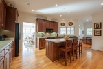 Kitchen includes ample countertop space, nice lighting, breakfast bar, and a small study area
