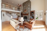 Spacious family room with floor to ceiling stone fireplace