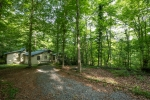 Home is nestled among mature hardwoods & overlooks Lake Forrest