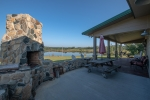 Outdoor patio and fireplace overlooking the stocked 8 acre lake