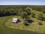 Barn, equipment building, stone firepit, well and chicken coop are located are centrally located