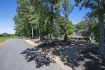 Circle driveway with mature landscaping and hardwoods