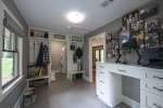 Spacious side entrance area with 1/2 bath and laundry room